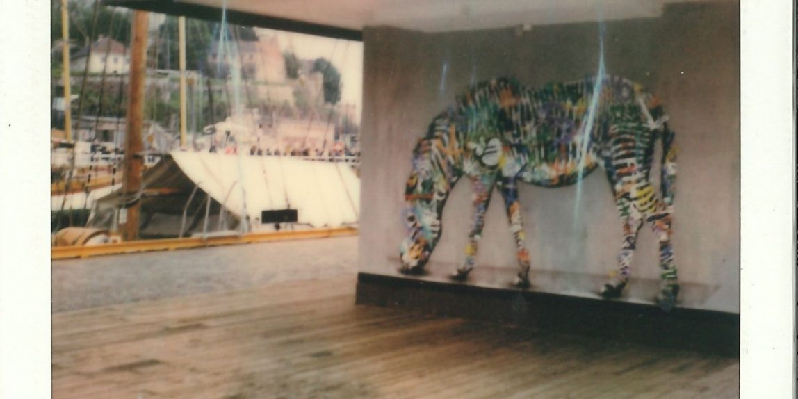 A painting of a zebra at the harbour of oslo